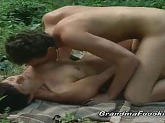Brunette mature rides a hard cock in the woods