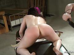 Purple-haired slave obeys her redhead mistress