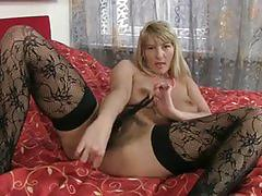 Busty blonde babe dildo fucking her hairy pussy.