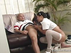 He plays with her hairy pussy and she sucks cock