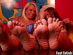 Evil dommes tease you with their sexy feet