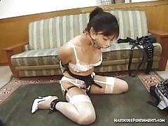 Asian face-fucked with mouth-opening device on