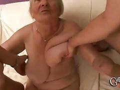 Busty granny gets pounded by two young studs