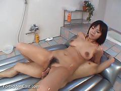 Cutie asian gets cummed on her oil covered titties