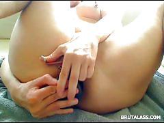 Hot brunette rubs her cunt and dildos her ass