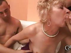 Blonde mature gets banged by two horny dudes