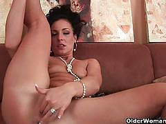 Horny brunette milf dildos her ass and cunt