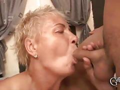 Sluty house wife granny sucking on two dicks.