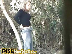 Horny blonde poses and takes a piss in the woods