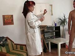 Redheaded painter rides her model's cock