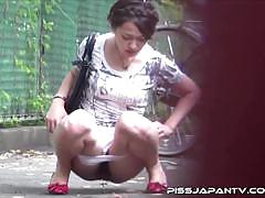 Japanese teen pissing outdoors