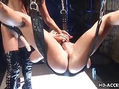 Two asian femdoms enjoys hot fuck with strap-on.