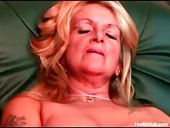 Nasty blonde mature plays with her cunt