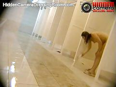 Hidden camera in public pool shower room.
