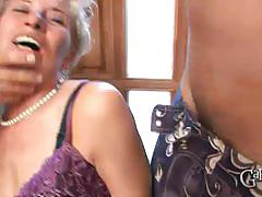 Granny enjoys two cocks