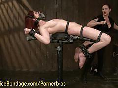 Redhead mistress fists her slave