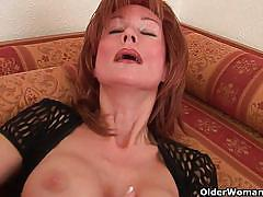 Mature red head lady masturbating her meaty pussy.