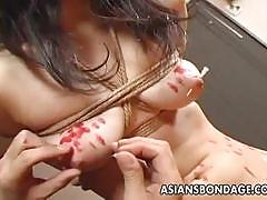 Japanese slut burned with hot wax after whipping