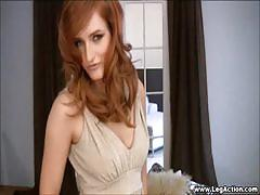 Redhead teases her pussy with heels