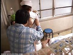 Japanese nurse rides her man's hard cock