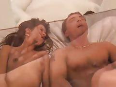 Blonde and brunette share a hard rod of meat