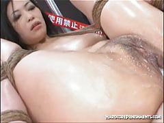 Asian brunette gets tied-up and vibrated