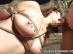 Jap busty babe gets her mouth fucked in bondage