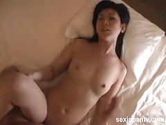 Sexy brunette japanese babe sucks and rides hard.