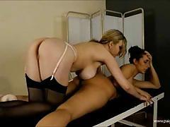 Blonde and busty masseuse plays with her friend