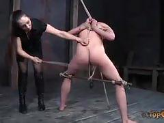 Brunette slave screams for pleasure