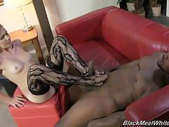 Jerking off a huge black cock with only her feet