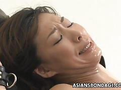 Jap patient restrained gets her hairy cunt fucked.