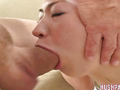 Filling her mouth with cock