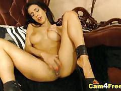 Sensual brunette finger fucks her moist pussy