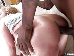 Blonde gets her ass owned by a black dick