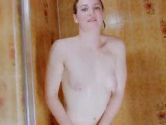 Lonely babe playing with the shower head