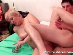 Mature blond takes dick while smoking