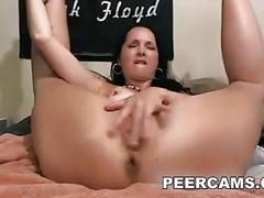 Hot mature babe using a big dildo on her pussy