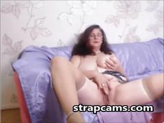 Mature chick with big tits masturbating on webcam