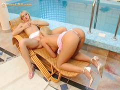 Hot lesbian couple dildoing each others.
