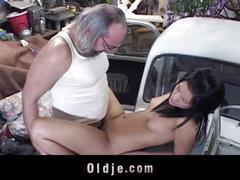 Old mechanic fucks hot brunette client on the car