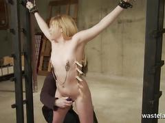 Her body is pinched and nipple clamped before pussy is played with