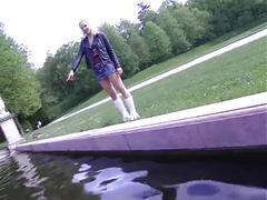 Girl walks around in park with butt plug and pissing