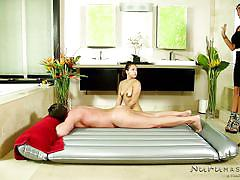 Romi shows the new girl how to relax the customer