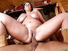Big tittied cowgirl sits on cock on the home couch