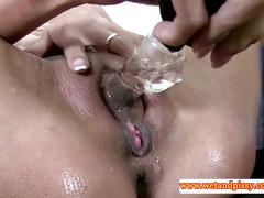 Solo brunette pissing in her clit pump