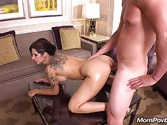 Tattooed milf fucked from behind