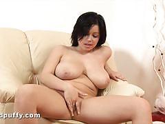 Busty brunette toys her moist pussy