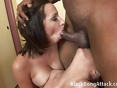 Two hot chicks suck on a black pole