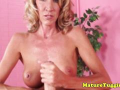 Busty mature milf jerking cock before cumshot